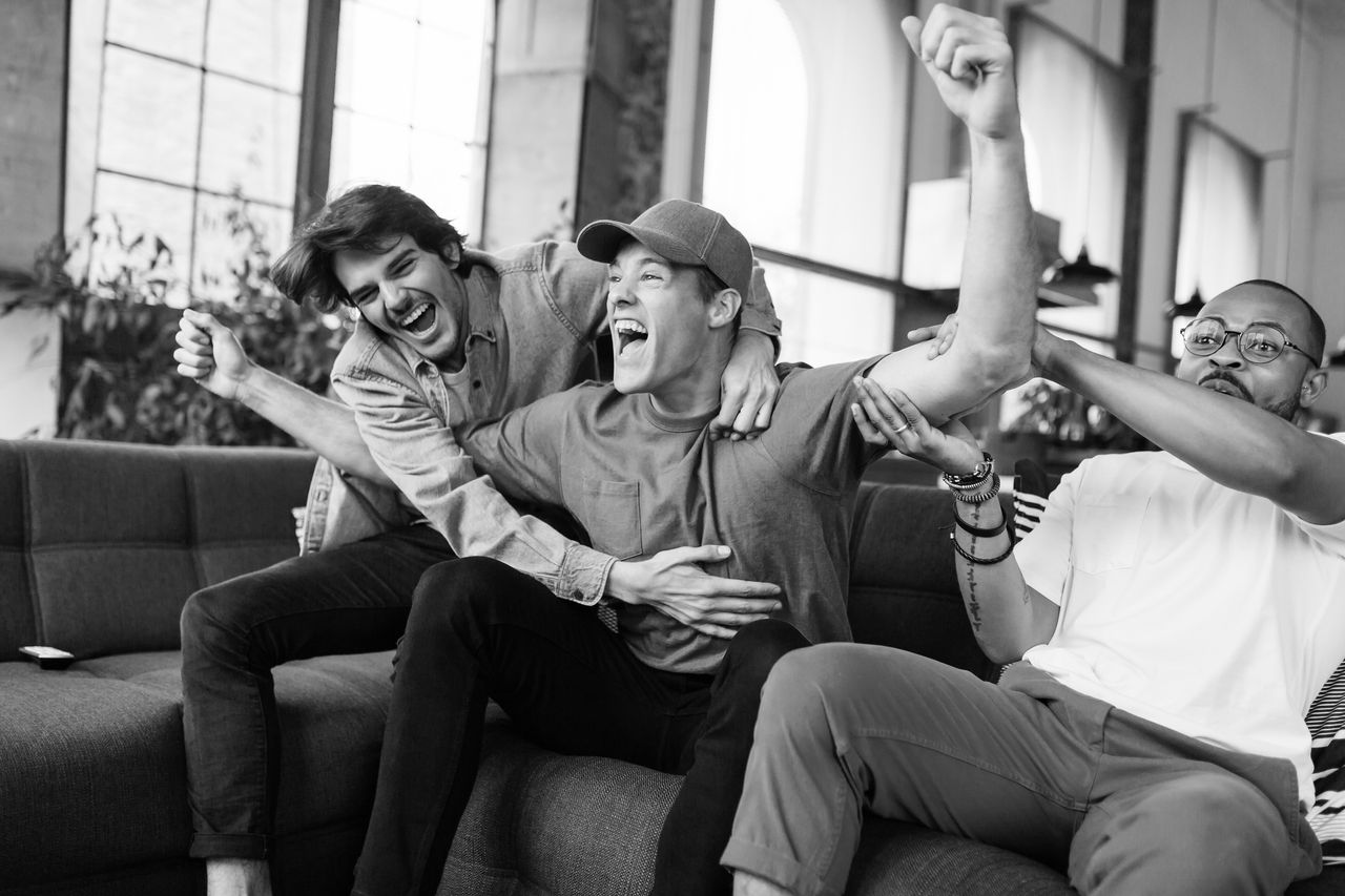 men celebrating bw